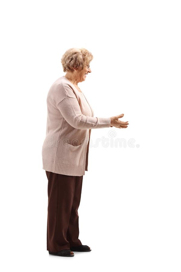 Senior woman gesturing with her hands as about to take something. Full lenght shot of a senior woman gesturing with her hands as about to take something isolated royalty free stock photos
