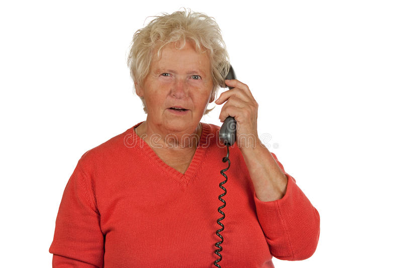 Senior woman gets a bad message on telephone royalty free stock photos