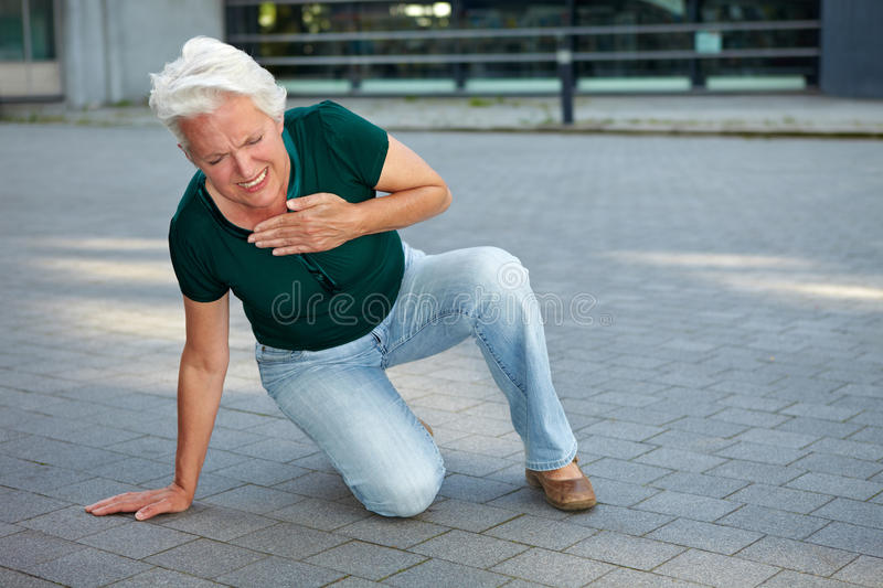 Senior woman getting heart attack royalty free stock image