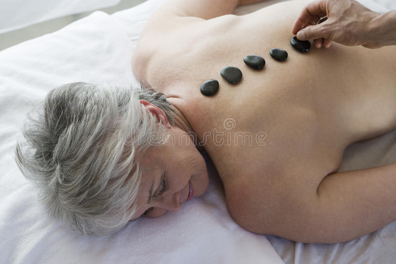 Senior Woman Getting Hot Stone Therapy stock image