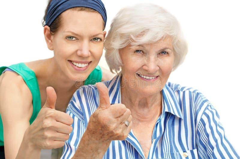 Senior woman and granddaughter royalty free stock photos