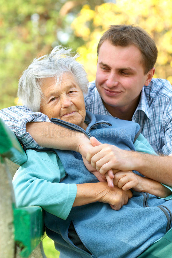 Senior woman and grandson stock images