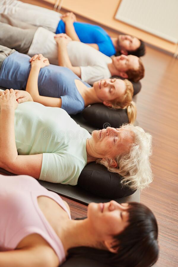 Senior woman in group doing meditation royalty free stock photos