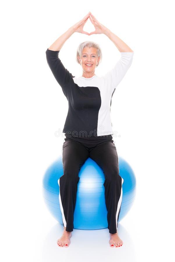 Senior woman gymnastic ball royalty free stock images