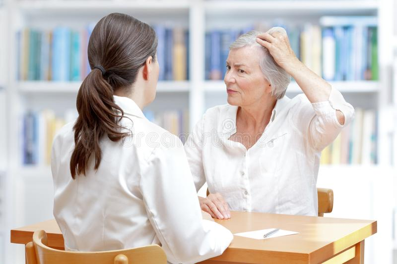 Senior woman hair loss doctor royalty free stock images