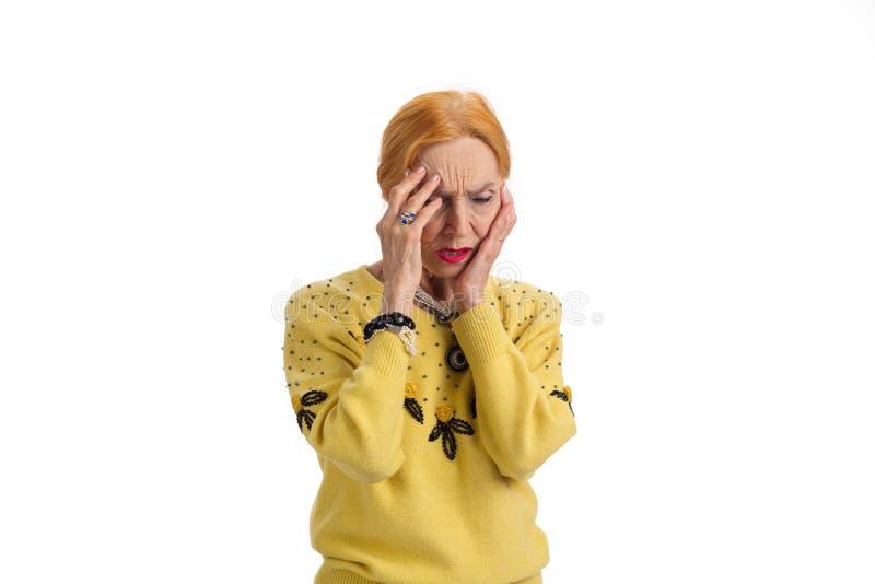 Senior woman has headache, isolated. stock image