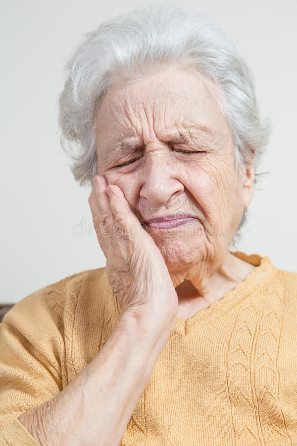 Senior woman has pain stock photo