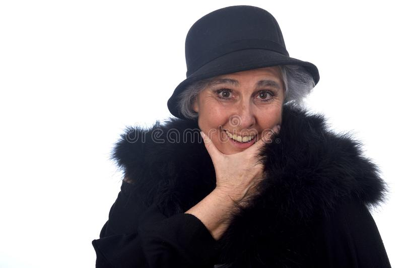 Senior woman with hat on white bacground. A senior woman with hat on white bacground royalty free stock images