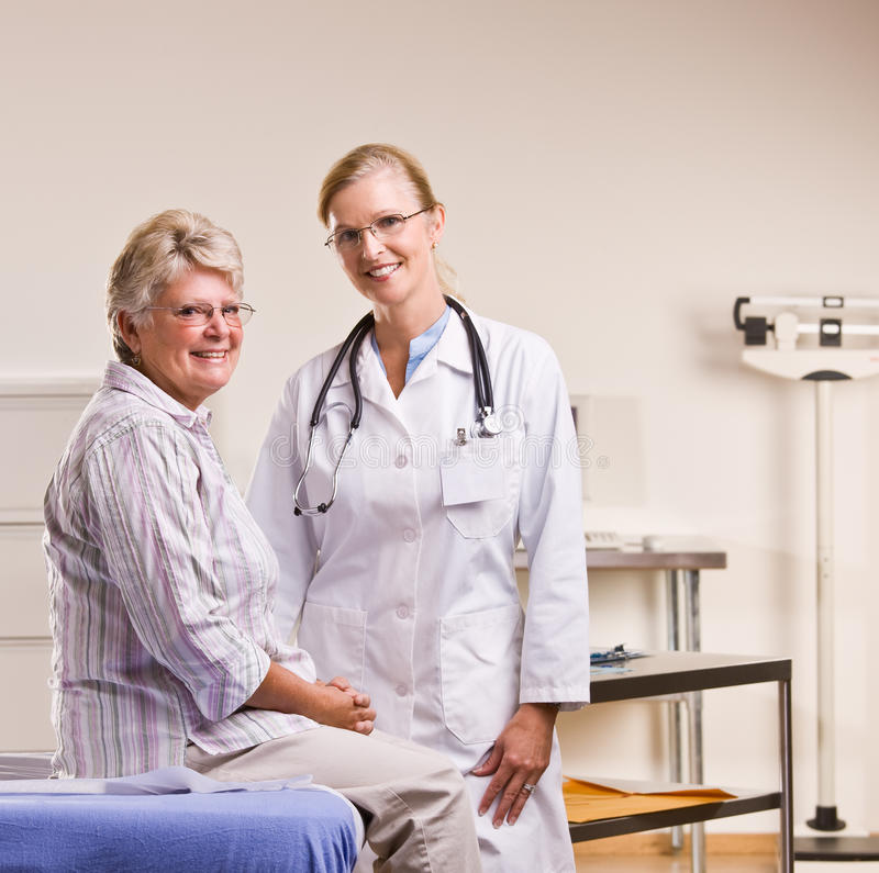Senior woman having checkup in doctor office.  royalty free stock photography