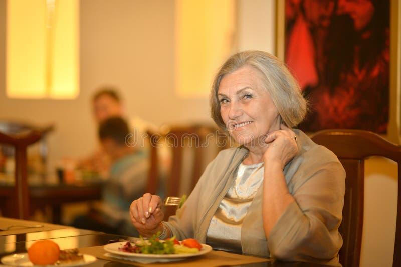 Senior woman having dinner royalty free stock photos