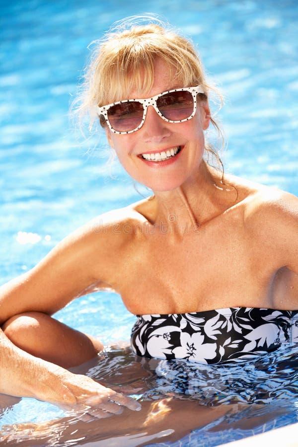 Download Senior Woman Having Fun In Swimming Pool Stock Photo - Image: 27706390