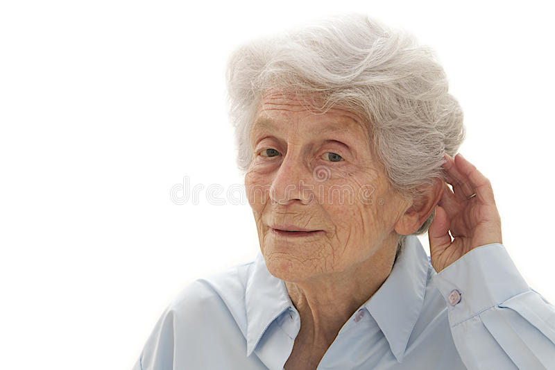 Senior woman with hearing problems. Old woman having difficulty in hearing isolated in a white background stock images