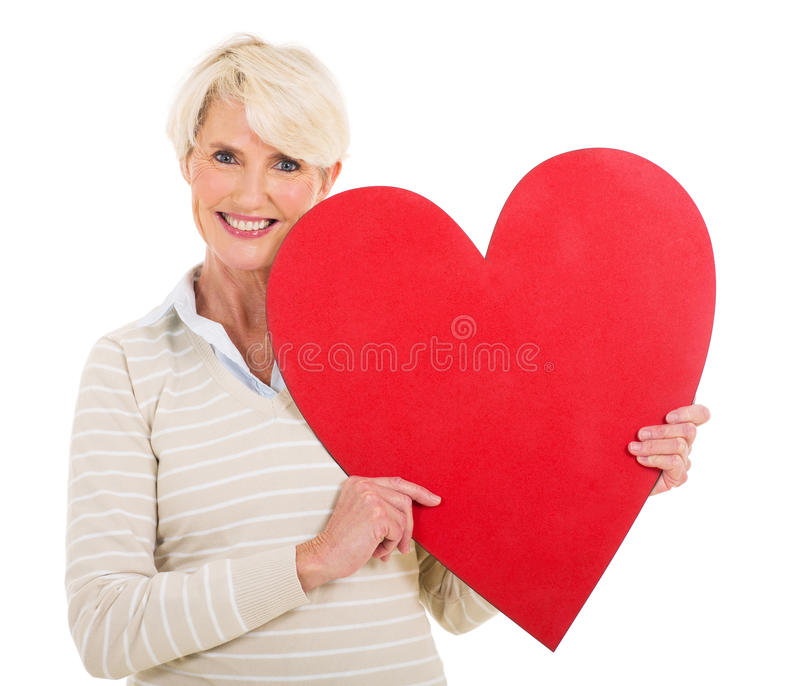 Senior woman with heart shape stock photography