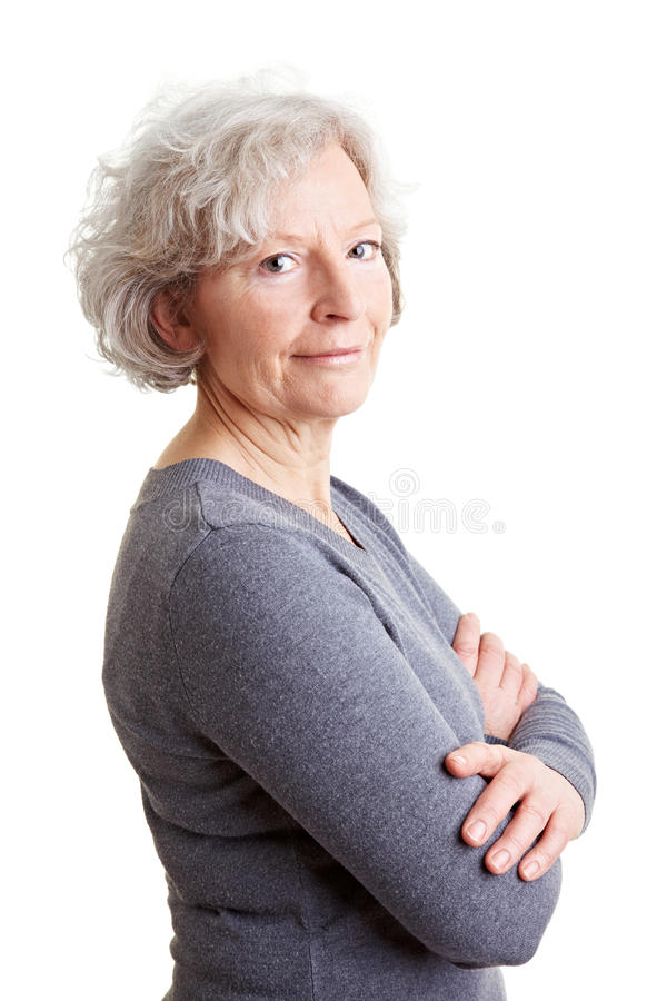 Senior Woman With Her Arms Crossed Stock Images