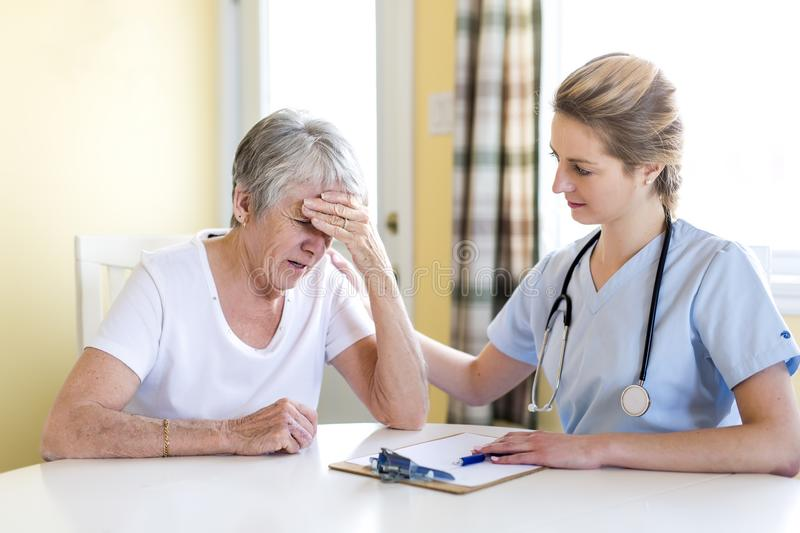 Senior woman with her caregiver at home. A Senior women with her caregiver at home stock photo