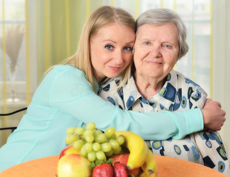 Senior woman with her caregiver. Senior women with her caregiver. Happy and smiling royalty free stock image