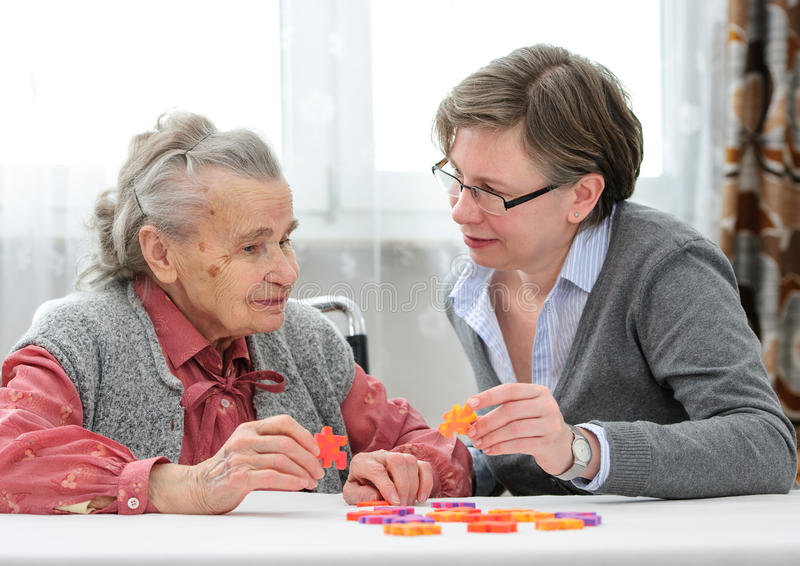 Senior woman with her elder care nurse stock photo