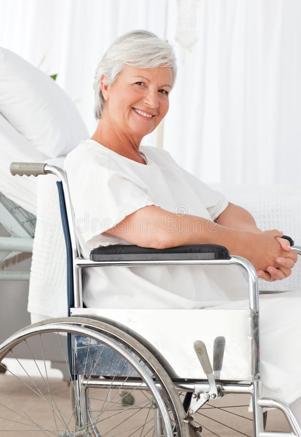 Senior Woman In Her Wheelchair In Hospital Royalty Free Stock Images