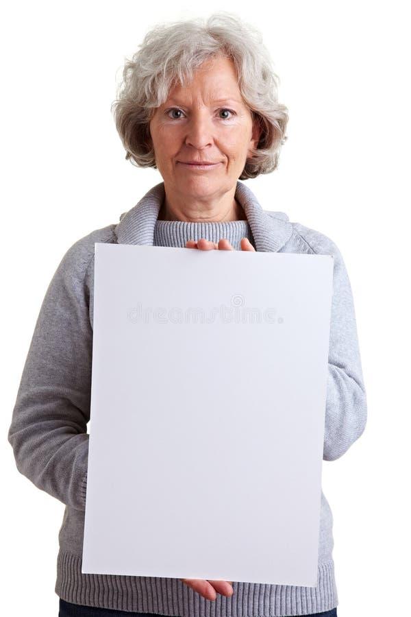 Senior Woman Holding Empty Stock Photos