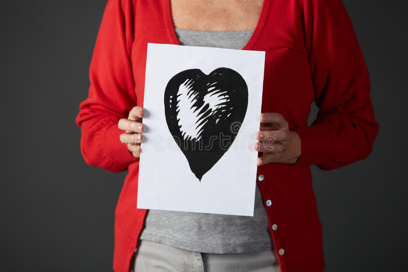 Download Senior Woman Holding Ink Drawing Of Heart Stock Image - Image of indoors, studio: 23959361