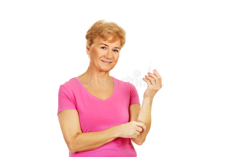 Senior woman holding medicament bottle.  royalty free stock photo