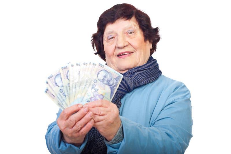 Senior woman holding Romanian money stock photo