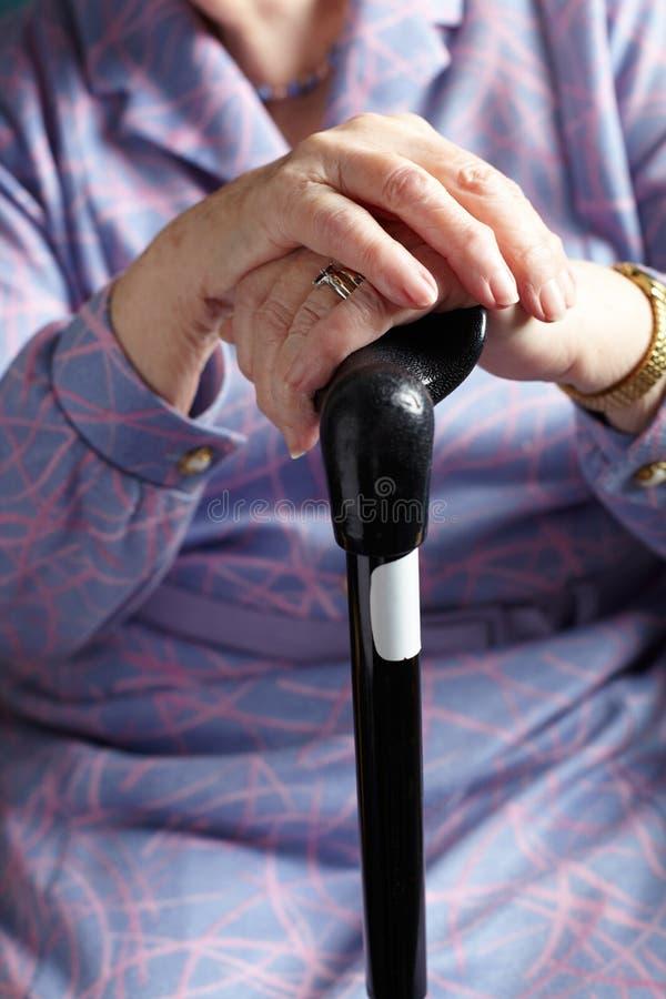 Senior Woman Holding Walking Stick. Close Up Of Senior Woman Holding Walking Stick stock image