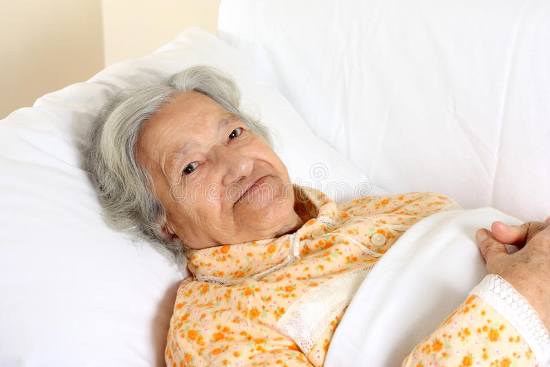 Senior woman in the hospital bed royalty free stock images