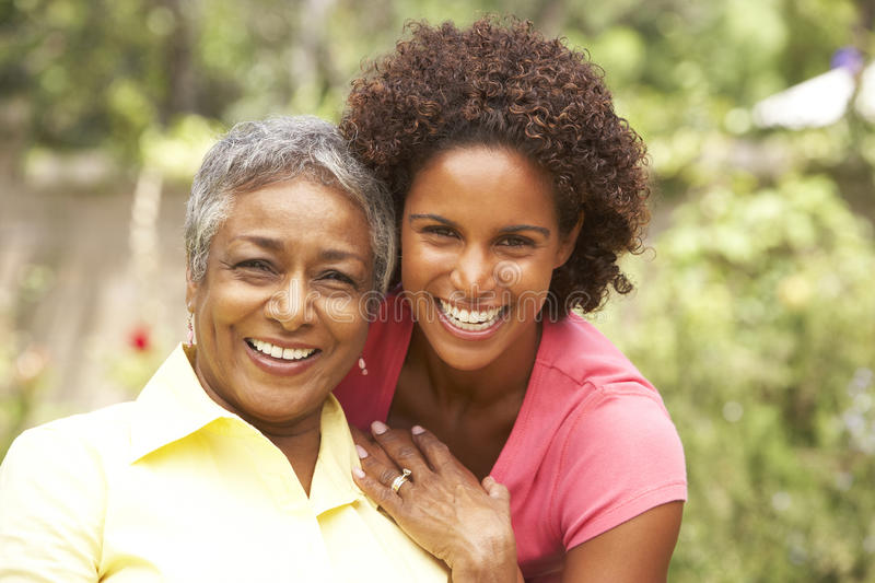 Senior Woman Hugging Adult Daughter stock photography