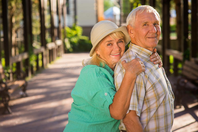 Senior woman hugs man. royalty free stock photography
