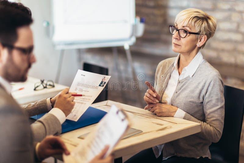 Senior woman, job applicants having interview royalty free stock photography