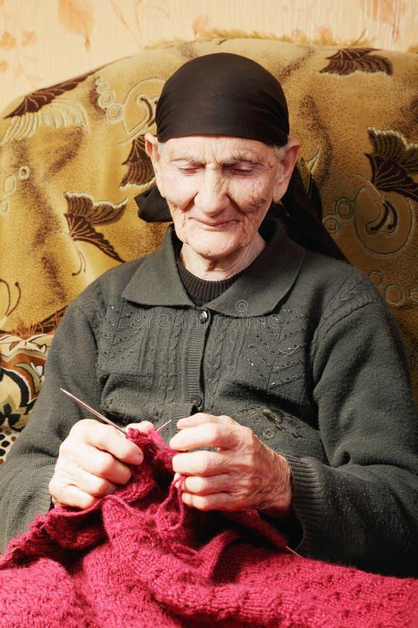 Senior woman at knitting royalty free stock photos