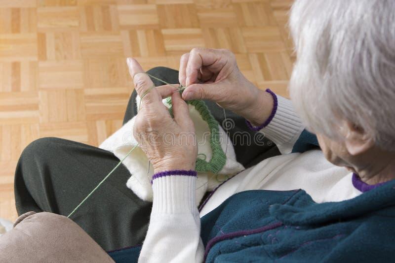 Senior Woman knitting royalty free stock photography