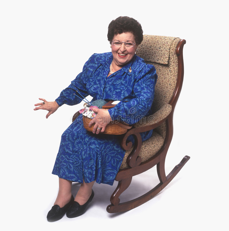 Senior Woman With Knitting On Rocking Chair Stock Photo