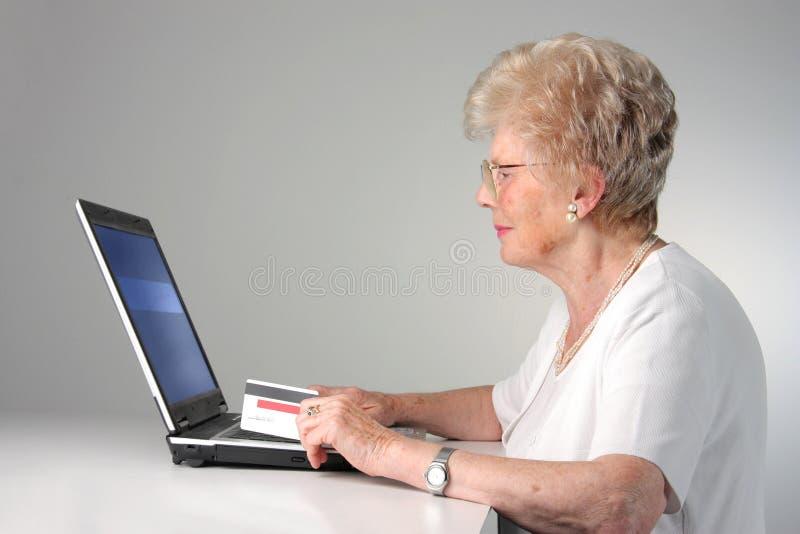 Senior woman with laptop stock photos