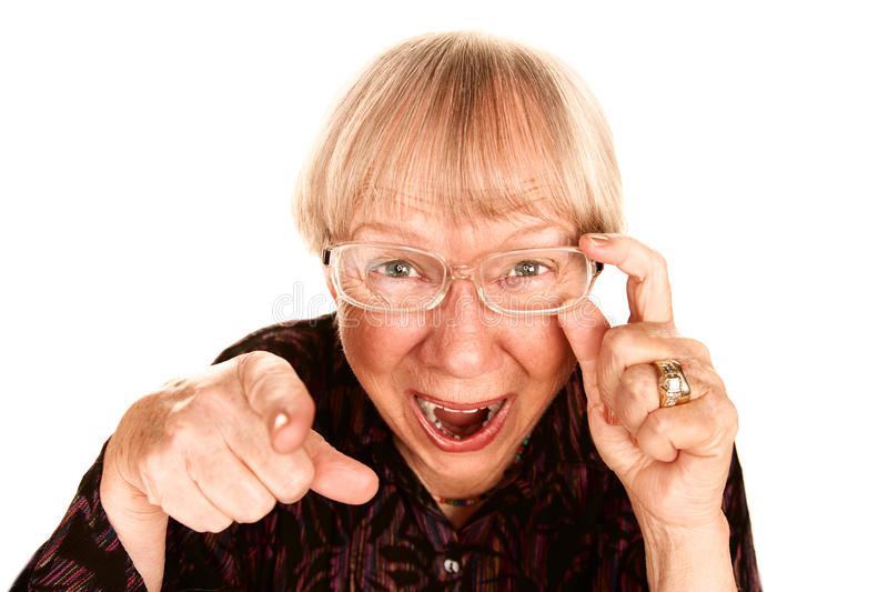 Senior woman laughing. Senior woman pointing her finger and laughing stock images