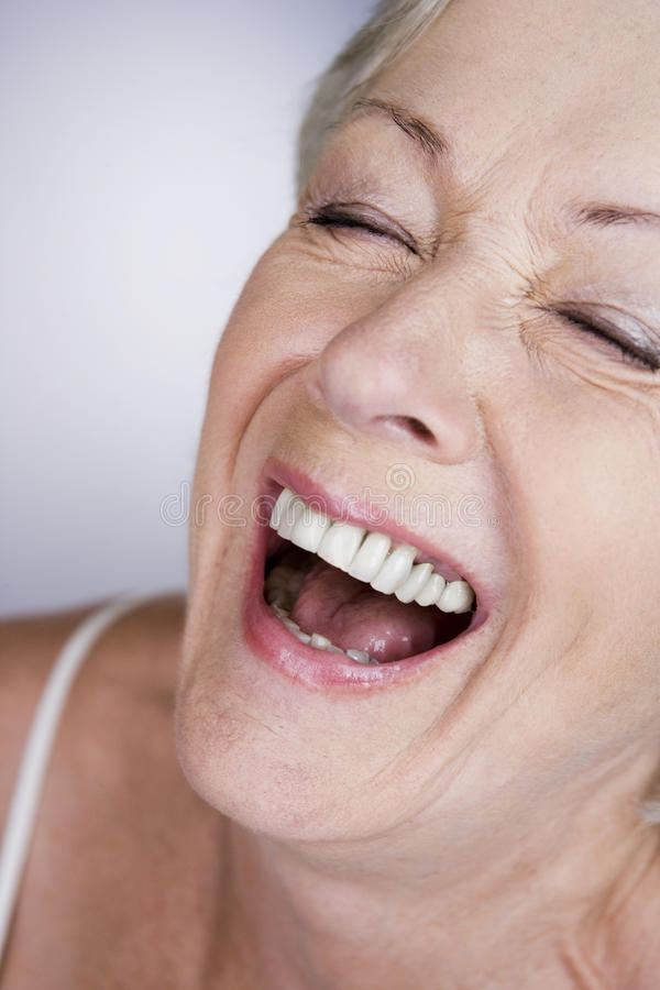 A senior woman laughing stock photography