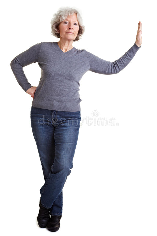 Download Senior Woman Leaning On Imaginary Stock Photo - Image: 18814554