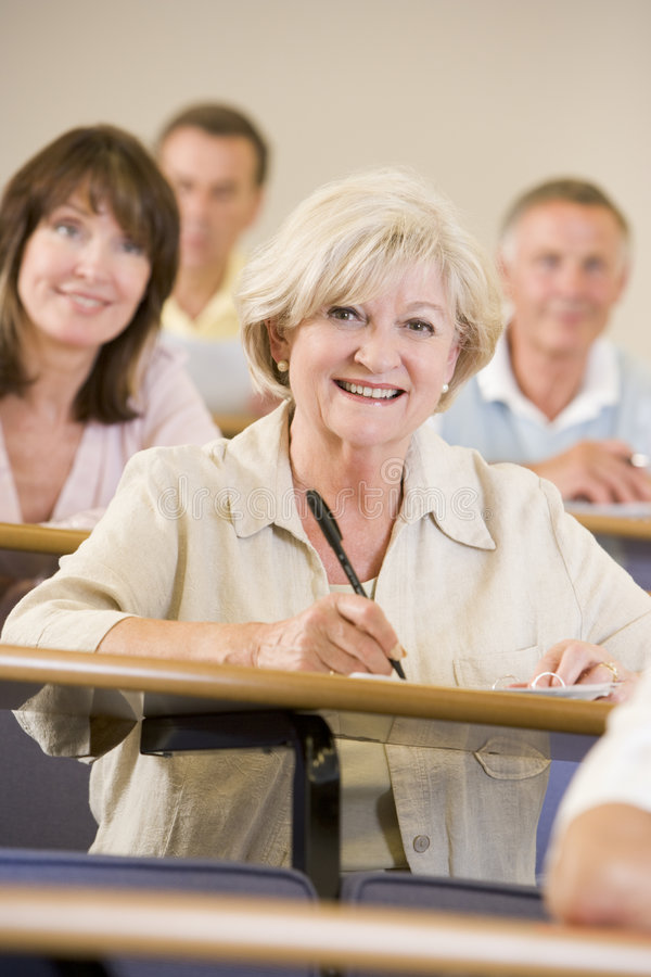 Free Senior Woman Listening To A University Lecture Stock Image - 7035201