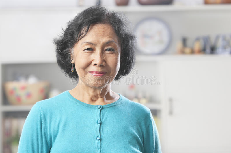 Senior woman looking at camera stock image