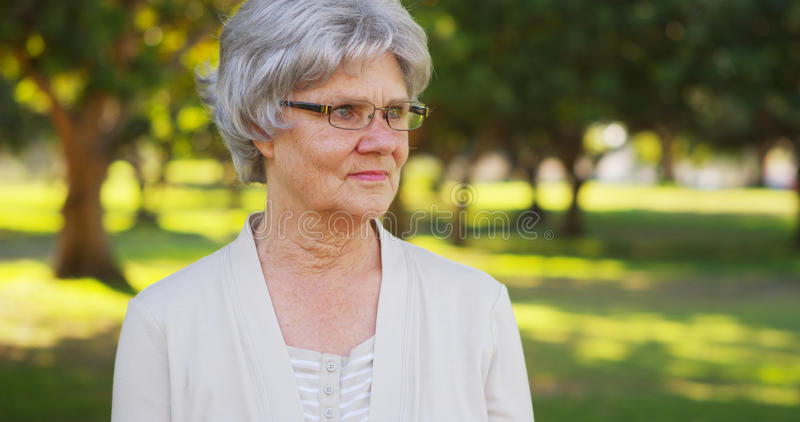 Senior woman looking off into the distance. Outdoors royalty free stock photography