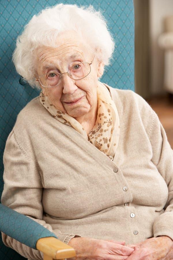 Senior Woman Sad Cry Rocking Chair Fireplace Stock Image