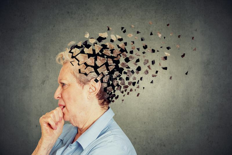Senior woman losing parts of head feeling confused as symbol of decreased mind function. stock image