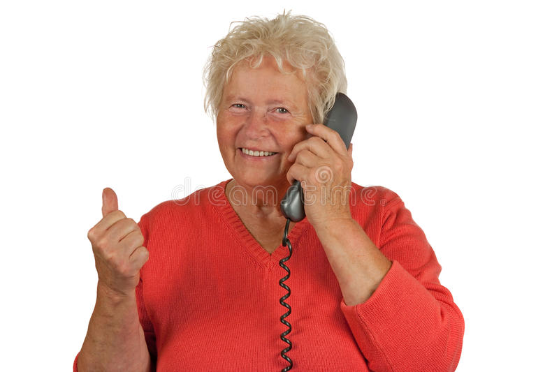 Download Senior Woman Makes OK Gesture On Telephone Royalty Free Stock Photography - Image: 20916897