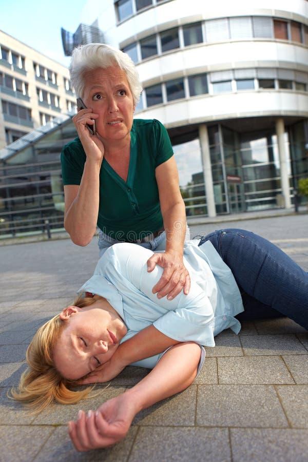 Senior Woman Making Emergency Call Stock Photo