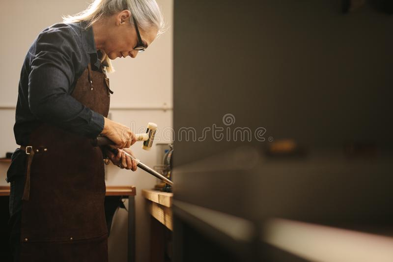 Senior woman making jewelry royalty free stock photography