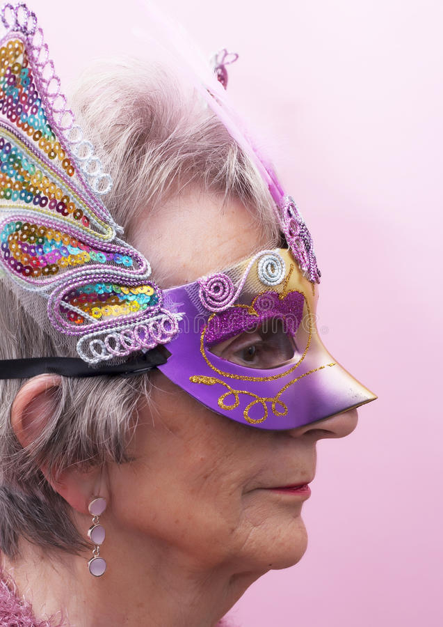 Senior Woman at Mardi Gras royalty free stock image