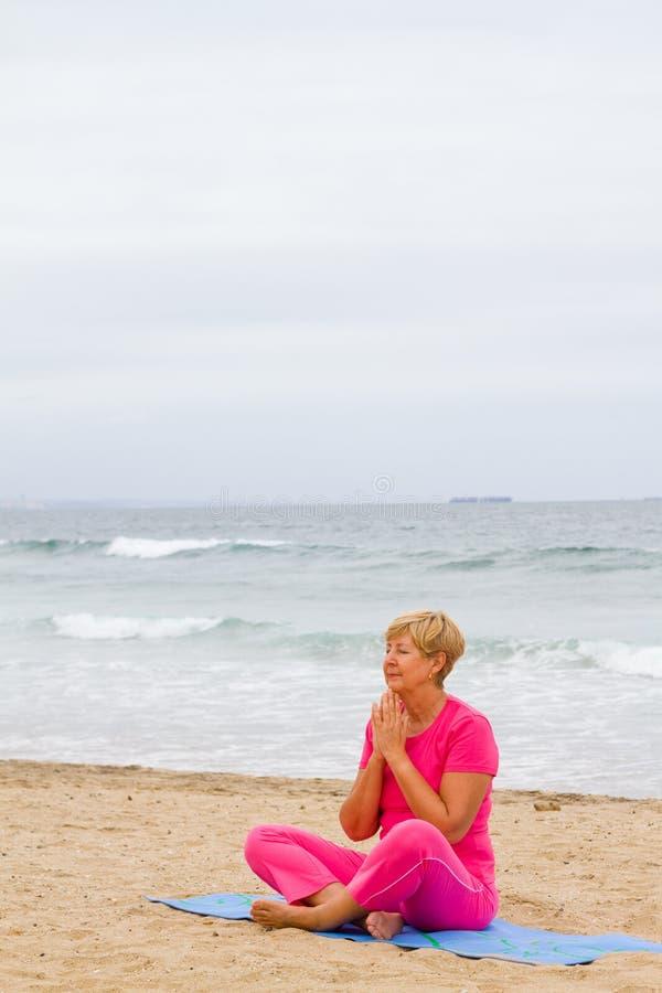 Download Senior woman meditation stock photo. Image of peaceful - 12632914