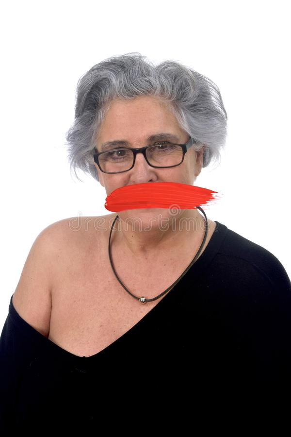 Senior woman with mouth covered on white stock images