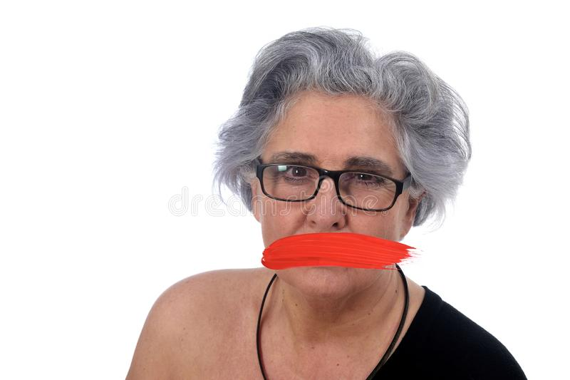 Senior woman with mouth covered on white stock photos